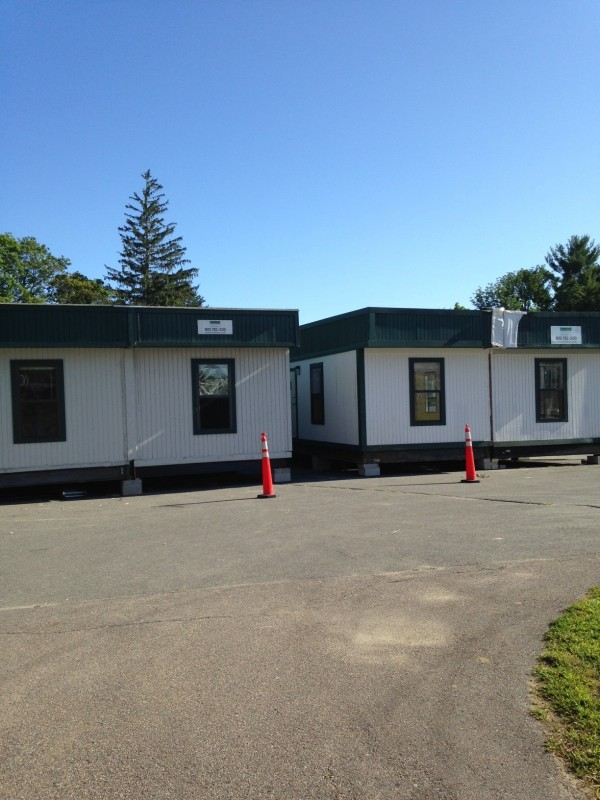Functional, if not yet exactly beautiful – temporary trailers will serve as welcome and exam space.