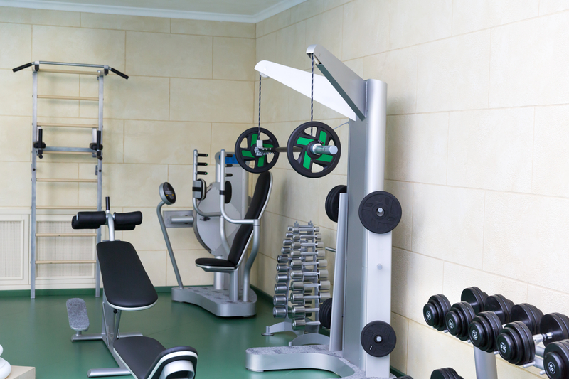 Fitness club gym with sport equipment modern interior